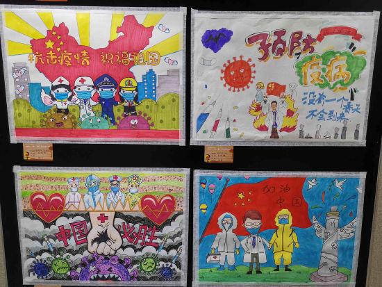 现场展出的书画作品,构图精巧、色彩缤纷、童趣盎然。